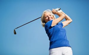Woman-Swinging-Golf-Club