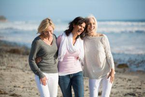 Trio of women walking at the beach